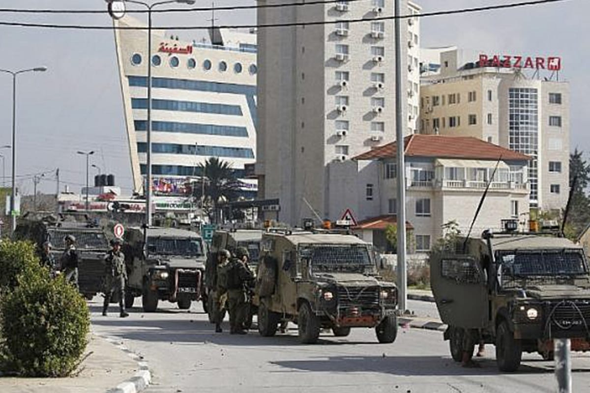 Israeli forces deploy during clashes in the West Bank city of Ramallah following a raid on Wafa news agency on 10 December, 2018 [Twitter]