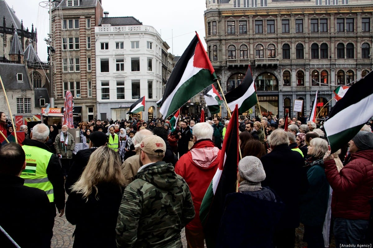"People gather at Dam Square holding flags and banners during a demonstration organized by ""Palestinian House in Netherlands"" Foundation, in support of Palestinian people, on December 30, 2018 in Amsterdam, Netherlands. The 'Return Key' monument, represents returning of Palestinians to their lands, was on display during the demonstration. ( Abdullah Aşıran - Anadolu Agency )"