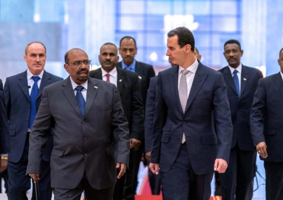 Sudanese President Omar Al-Bashir becomes the first Arabic leader to meet his Syrian counterpart Bashar Al-Assad in eight years on 16 December 2018 - [Syrian Presidency/Facebook]