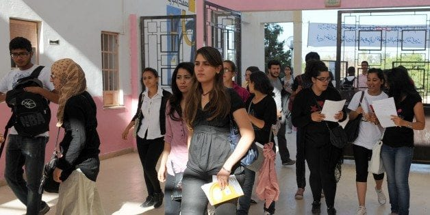 Tunisian students arrive to take the baccalaureate (high school graduation exam) exam on June 6, 2012 at a high school in Tunis. [Fethi Belaid/AFP/Getty Images]