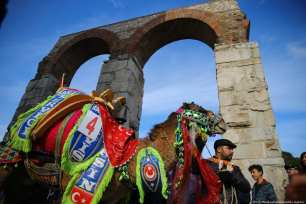 """A camel walks during the 8th """"Fanciest Camel"""" competition organized within the 37th Traditional Selcuk Efes Camel Wrestling Festival at Selcuk Station Square in Turkey on 19 January 2019 [Emin Mengüarslan/Anadolu Agency]"""