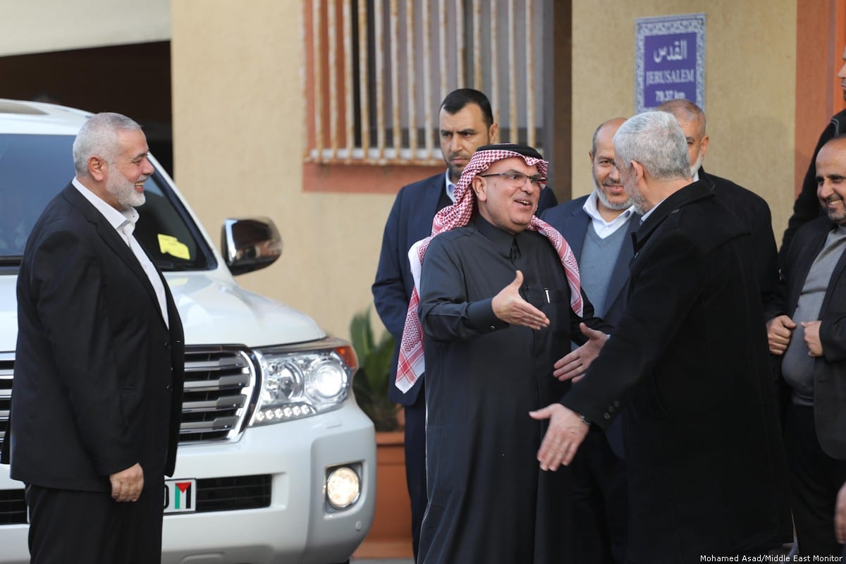 Qatar ambassador Mohammed El-Amadi (C) is greeted by Head of Hamas in Gaza Yahya Sinwar (R) and other officials in Gaza on 24 January 2019 [Mohamed Asad/Middle East Monitor]