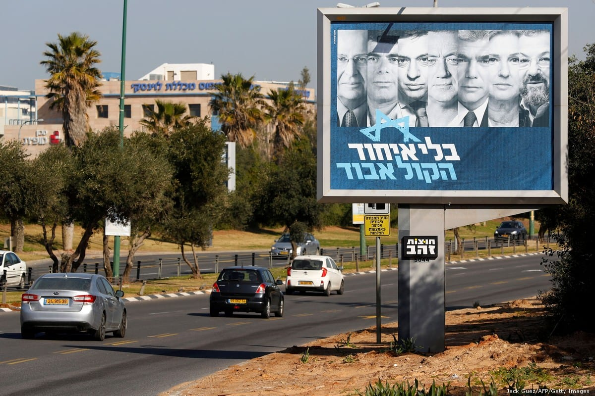 Posters of candidates for Israel's upcoming general election in April, on 23 January 2018 [Jack Guez/AFP/Getty Images]