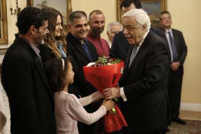 Egyptian migrants Ibrahim Mahmoud Mousa (L), and Al Haimi Emad, and Albanian migrant Jake Gani are honoured with Greek citizenship for saving the lives of tens of people in July's fire disaster near the capital Athens, by Greek President Prokopis Pavlopoulos (R) with an official ceremony at the Greek Presidency Building in Athens, Greece on 2 January, 2019 [Ayhan Mehmet/Anadolu Agency]