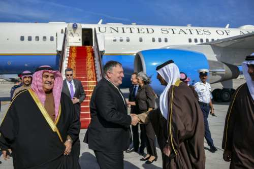 US Secretary of State Mike Pompeo (C) is being welcomed by Bahraini Foreign Minister Khalid bin Ahmed Al Khalifa (L) and officials at the Bahrain International Airport in Manama, Bahrain on January 11, 2019. ( U.S. Department of State / Handout - Anadolu Agency )