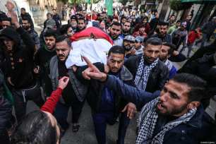 Dead body of Palestinian woman, Amal Mustafa Abu Sultan, 44, who was killed by Israeli army gunfire while taking part in ongoing demonstrations near the Gaza-Israel buffer zone, is being carried during her funeral ceremony in Gaza on January 12, 2019 [Mustafa Hassona / Anadolu Agency]