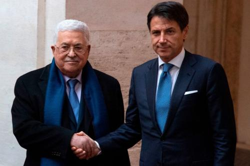 Italian Prime Minister Giuseppe Conte shakes hands with Palestinian President Mahmoud Abbas before their meeting at the Chigi Palace in Rome on 3 December 2018 [Photo by Tiziana FABI / AFP / Getty Images]