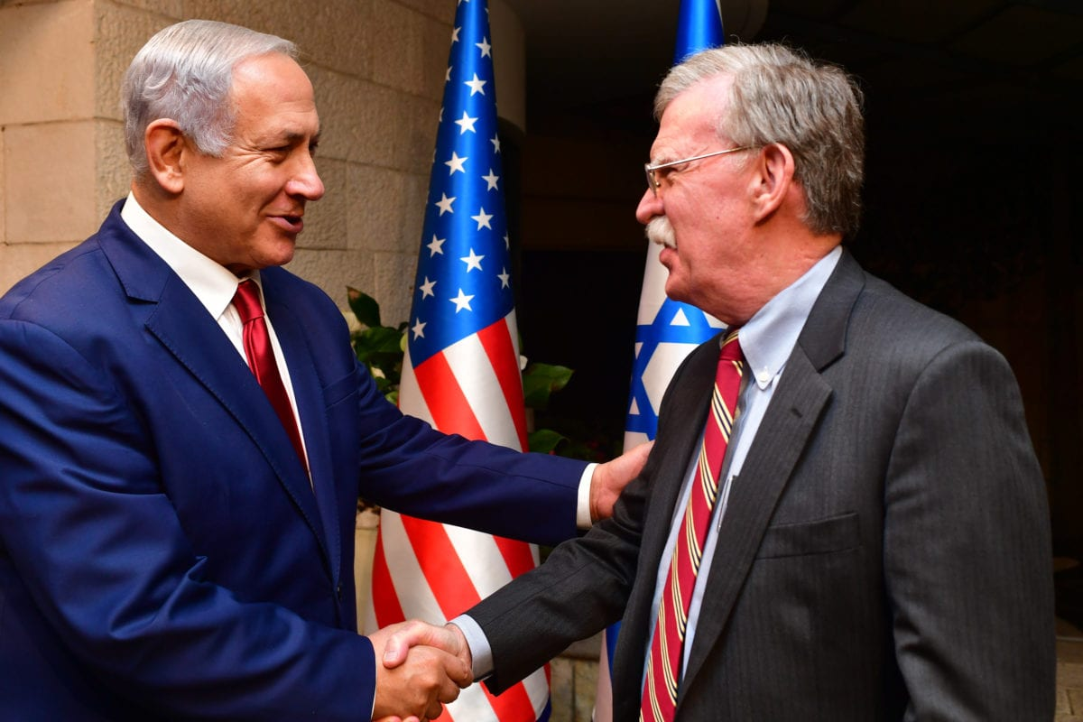 Israeli Prime Minister Benjamin Netanyahu shakes hands with White House National Security Adviser John Bolton as they meet on 6 January 2019, in Jerusalem, Israel. [Kobi Gideon/GPO/Getty Images]