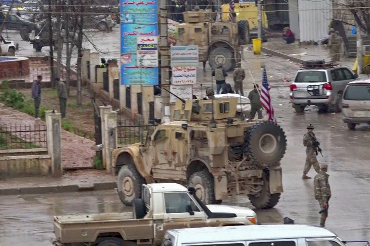 US troops gathered at the scene of a suicide attack in Syria [AFP/Getty Images]