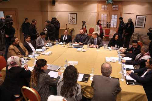 Representatives of Yemen's Huthi rebels and a Yemen government delegation meet in the Jordanian capital Amman on 17 January 2019 [KHALIL MAZRAAWI/AFP/Getty Images]