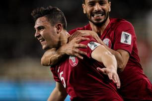 Pedro Miguel of Qatar celebrates after scoring a goal to make it 1-0 during the AFC Asian Cup round of 16 match between Qatar and Iraq at Al Nahyan Stadium on 22 January 2019 in Abu Dhabi, United Arab Emirates. [Matthew Ashton - AMA/Getty Images]