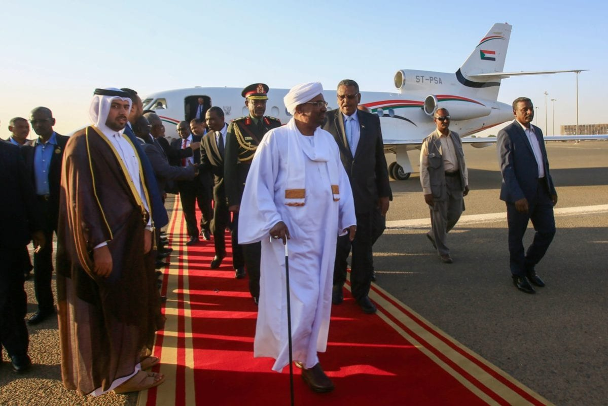 Sudan's President Omar al-Bashir (C) is received by Vice President Bakri Hassan Saleh (C-R) upon his return from Qatar, at Khartoum International Airport outside the capital on January 23, 2019. [ASHRAF SHAZLY/AFP/Getty Images]