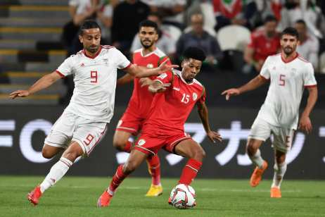 Omid Ebrahimi Zarandini (L) of Iran and Jameel Al Yahmadi of Oman compete for the ball during the AFC Asian Cup round of 16 match between Iran and Oman at Mohammed Bin Zayed Stadium on 20 January 2019 in Abu Dhabi, United Arab Emirates. [Etsuo Hara/Getty Images]