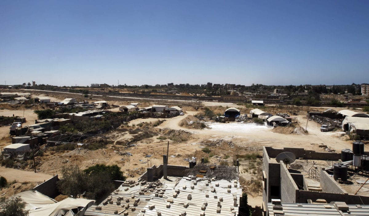 A view of tents covering the smuggling tunnels along the Egypt-Gaza border is seen from Rafah, southern Gaza Strip, on August 22, 2012(Photo by MOHAMMED ABED/AFP/GettyImages)