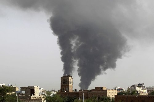 Smoke billows following air-strikes by the Saudi-led coalition on a weapons depot at a military airport, currently controlled by Yemeni Shiite Huthi rebels, on July 7, 2015 in the capital Sanaa. [MOHAMMED HUWAIS/AFP/Getty Images]