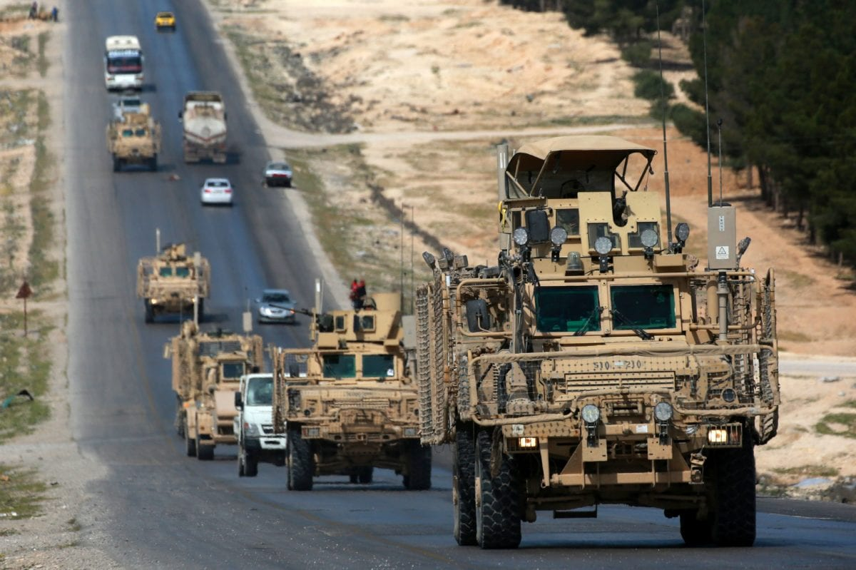 Vehicles of US-backed coalition forces driving in the northern Syrian town of Manbij, seen on 3 April , 2018 [DELIL SOULEIMAN/AFP/Getty Images]