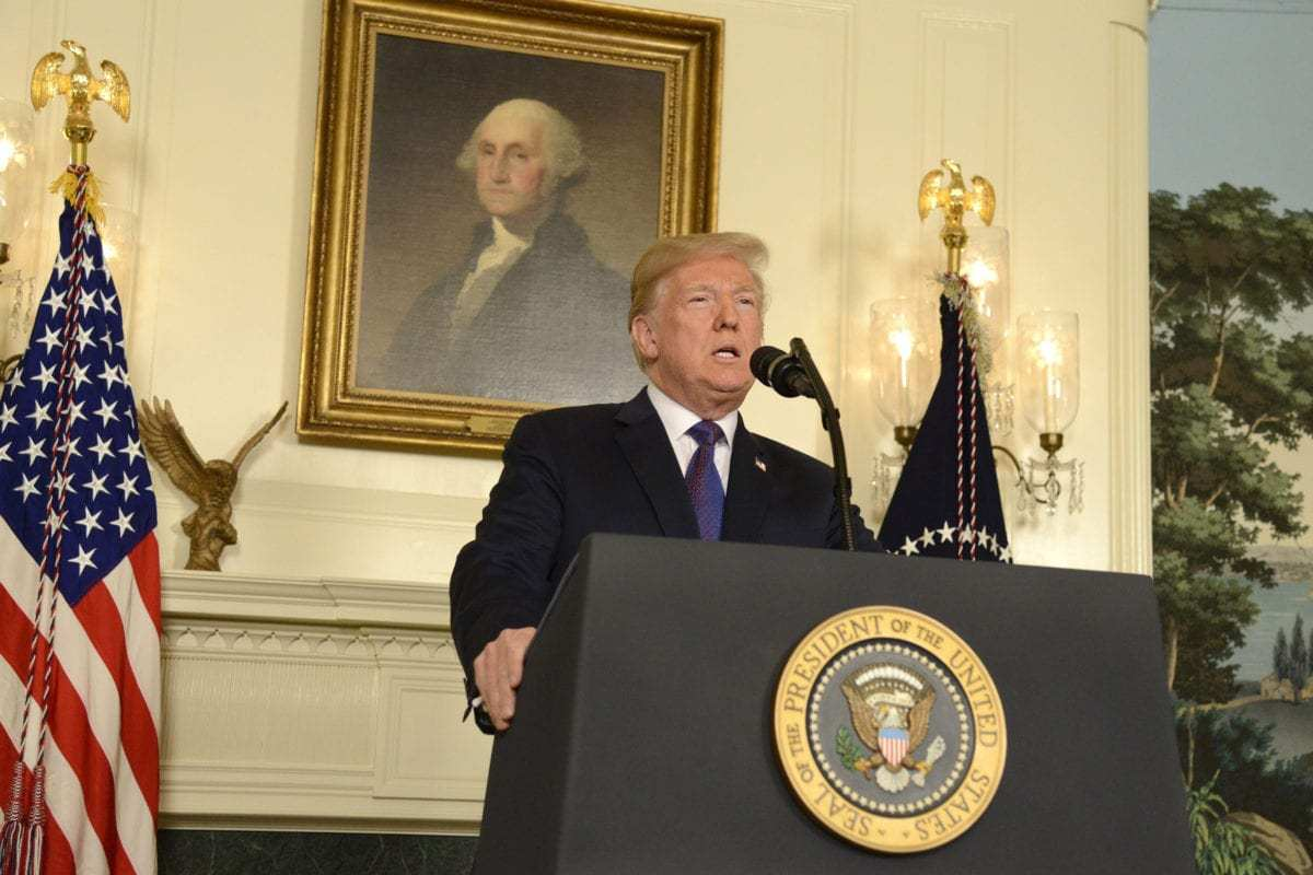US President Donald Trump during his speech to the nation, announcing military action against Syria for the recent apparent gas attack on its civilians, at the White House, in Washington, US on 13 April 2018 [Mike Theiler/Pool/Getty Images]