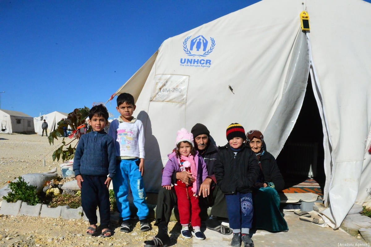 Syrian kids pose for a photo at a tent camp, built by Prime Minister's Disaster and Emergency Management in Suruc district of Sanliurfa, Turkey on January 9, 2018. ( Rauf Maltaş - Anadolu Agency )