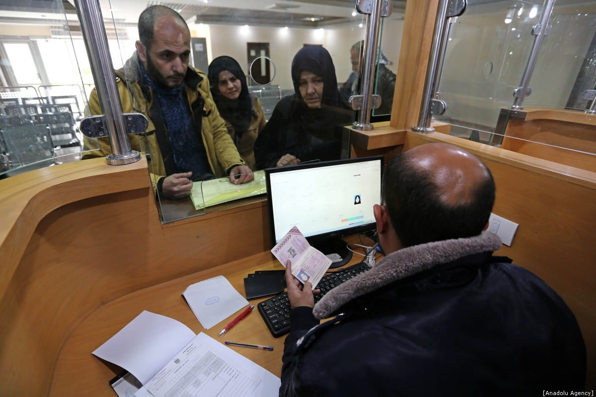 Palestinians stranded in Egypt queue for passport transactions at border gate after Egyptian authorities opened the Rafah border crossing in Gaza City, Gaza on January 8, 2019. ( Ashraf Amra - Anadolu Agency )