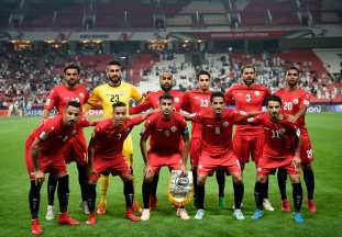 The Yemeni football team pose for a group photograph prior to the start of the 2019 AFC Asian Cup Group D, football match between Yemen and Iran, for which they qualified for the Asian Cup 2019 at the Mohammed Bin Zayed stadium in Abu Dhabi on 7 January 2019 [Photo by KHALED DESOUKI / AFP/Getty Images]
