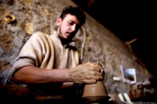 Turkish craftsmen Yenal Yorgun and Mustafa Alkan (not seen) make clay pots in Cappadocia's Avanos district, Nevsehir, Turkey on 5 February 2019 [Behçet Alkan/Anadolu Agency]