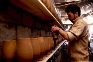 Turkish craftsmen Yenal Yorgun (R) and Mustafa Alkan (L) make clay pots in Cappadocia's Avanos district, Nevsehir, Turkey on 5 February 2019 [Behçet Alkan/Anadolu Agency]