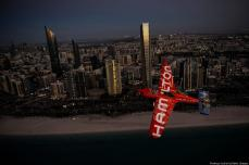 In this handout provided by Red Bull, Nicolas Ivanoff of France flies over the skyline prior to the first stage of the Red Bull Air Race World Championship in Abu Dhabi on 6 February 2019 [Predrag Vuckovic/Getty Images]
