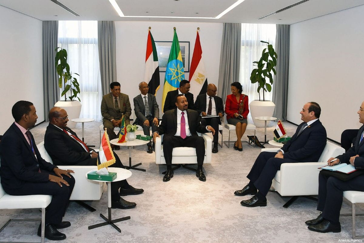 Ethiopian Prime Minister Abiy Ahmed (C), Egyptian President Abdel Fattah al-Sisi (R2) and Sudan's President Omar Al Bashir (L2) take part in a tripartite summit regarding a dam on the Nile River, in Addis Ababa, Ethiopia on 10 February 2019. [Presidency of Egypt / Handout - Anadolu Agency]