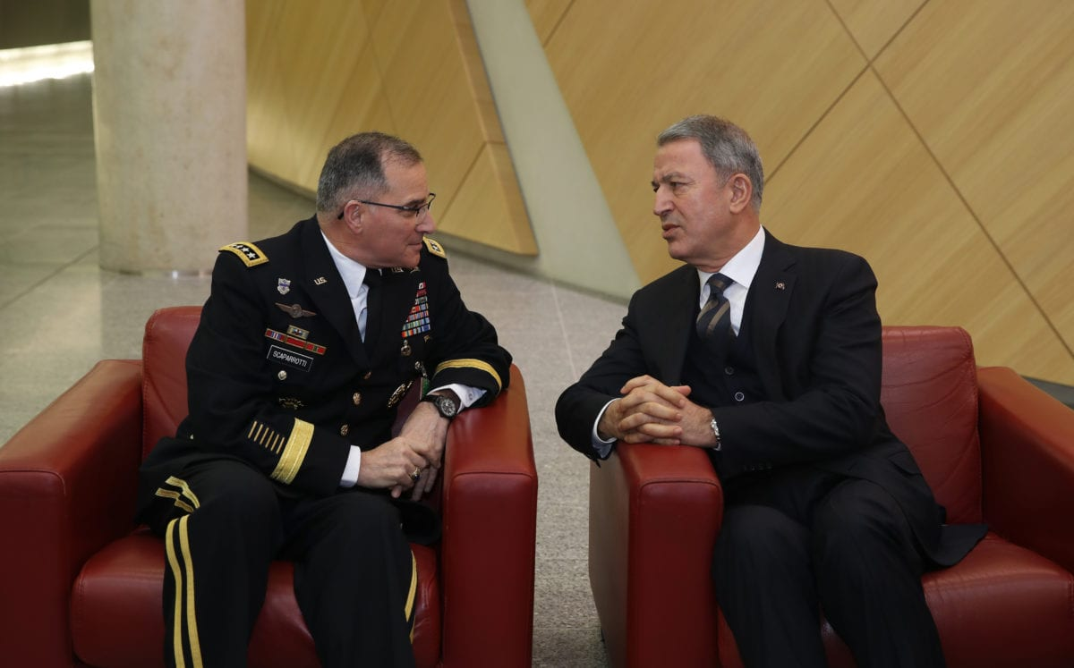 Turkish National Defense Minister Hulusi Akar (R) meets with Curtis Michael Scaparrotti (L), a four-star general in the United States Army, and current Supreme Allied Commander Europe (SACEUR) of NATO Allied Command Operations within the NATO Defence Ministers' Meeting at the NATO Headquarters in Brussels, Belgium on 13 February 2019. [Arif Akdoğan - Anadolu Agency]