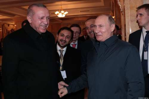Russian President Vladimir Putin (R) sees Turkish President Recep Tayyip Erdogan (L) off after they attend a meeting with Iranian President Hassan Rouhani (not seen) and President of Belarus Alexander Lukashenko (not seen) at 'Rus Sanatorium' following the 4th trilateral summit on Syria between Turkey - Iran - Russia, on 14 February 2019 in Sochi, Russia. [Turkish Presidency / Murat Cetinmuhurdar / Handout - Anadolu Agency]