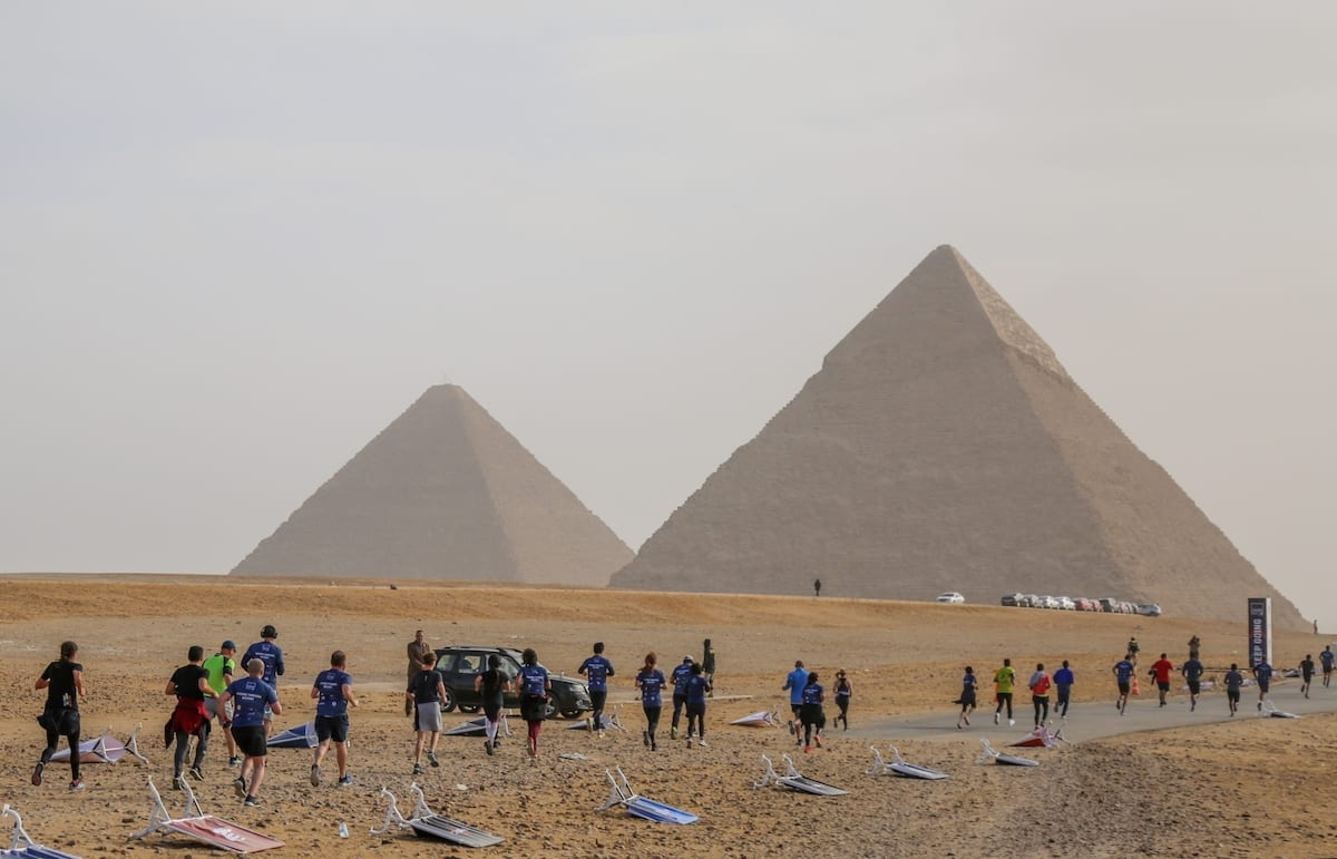 People gather to attend a public run with the attendance of four thousands people from different countries, around the Great Pyramid of Giza, which is located in the western part of capital city Cairo, in Egypt on 15 February 2019. [Ahmed Al Sayed - Anadolu Agency]