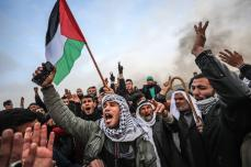 "Palestinians shout slogans as Israeli forces intervene protestors during a ""Great March of Return"" demonstration at Huzaa district of Khan Yunis, Gaza on 15 February 2019. [Mustafa Hassona - Anadolu Agency]"