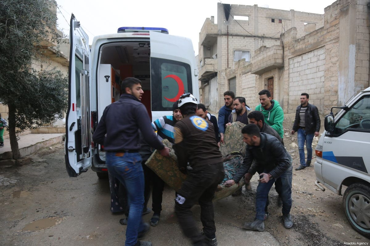 An injured person is being taken to an ambulance to receive a treatment after Assad Regime forces' artillery units attacked within the borders of the tension reduction zone determined for Idlib in Khan Shaykhun district of Idlib, Syria on 15 February, 2019 [Enes Diyab/Anadolu Agency]