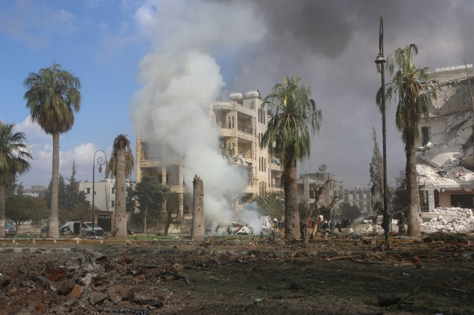 Smoke rises around the damaged buildings at the site after the consecutive bomb attacks with two bomb-laden vehicles in Idlib city centre, Syria on 18 February, 2019 [Ahmet Rehhal/Anadolu Agency]