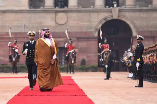 Crown Prince of Saudi Arabia Mohammad bin Salman (R) is welcomed Indian Prime Minister Narendra Modi (not seen) with an official welcoming ceremony at presidential palace in New Delhi, India on 20 February 2019. [Indian Foreign Ministry / Handout - Anadolu Agency]
