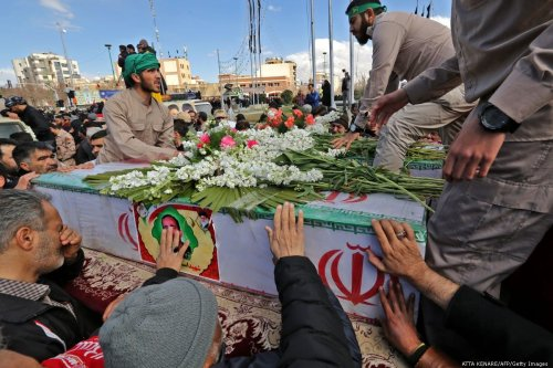 Relatives touch the coffin of a member of Revolutionary Guards, who was killed in a suicide attack, in Iran on 16 February 2019 [ATTA KENARE/AFP/Getty Images]