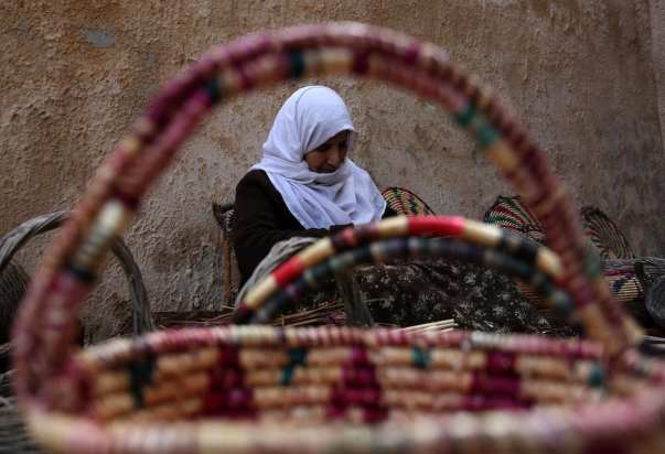 Mariyam Haj Ali, 86-year-old Palestinian woman, makes trays and baskets using wheat and olive straws, at her home in the village of Jama'in near the West Bank city of Nablus, on 27 February 2019. [Shadi Jarar'ah - Apaimages]