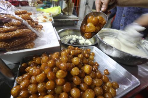 Awameh is a popular Middle Eastern dessert [Mohammed Asad/Middle East Monitor]