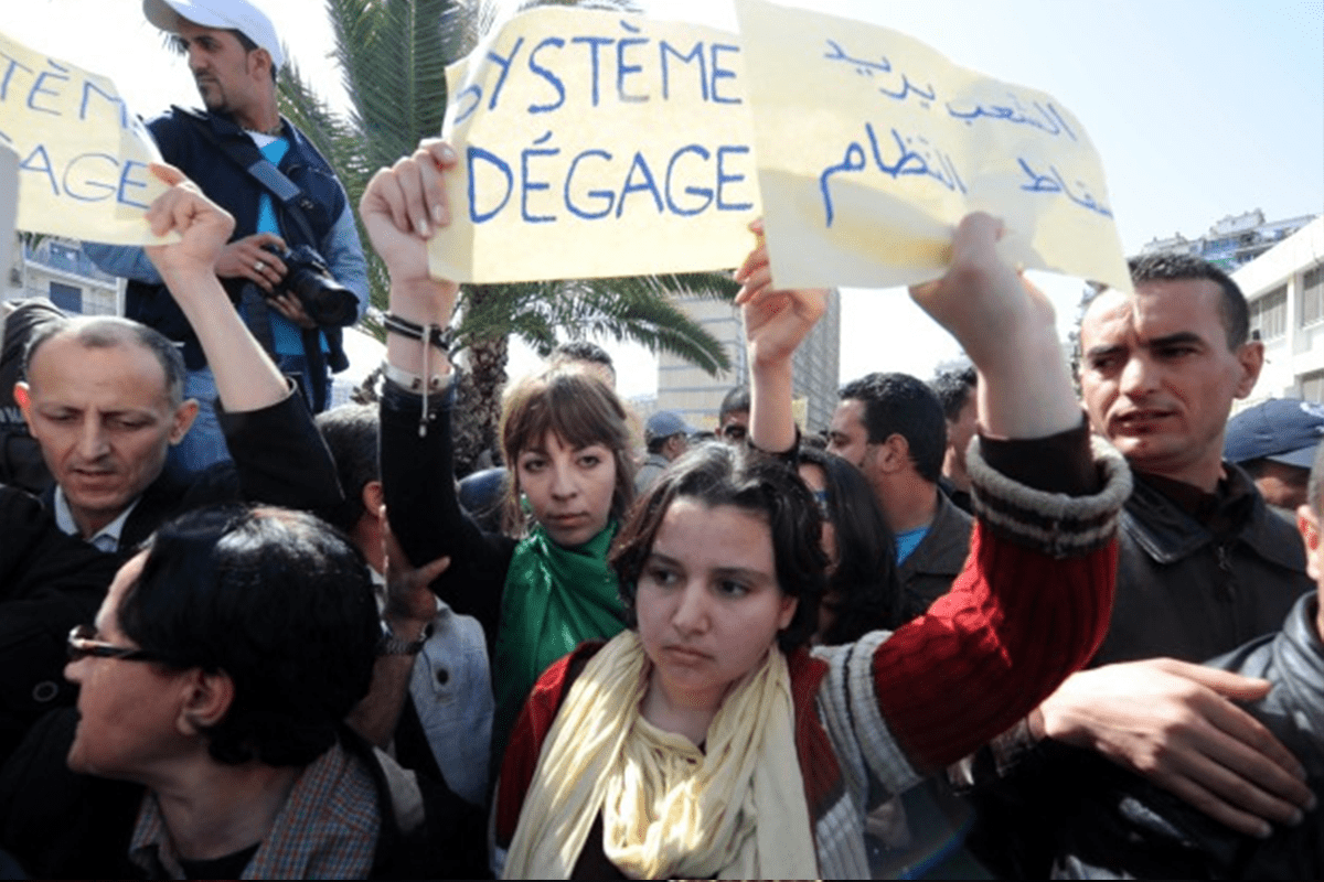 Youth protesting against the established government in Algeria in 2011 [AFP/Getty images ]