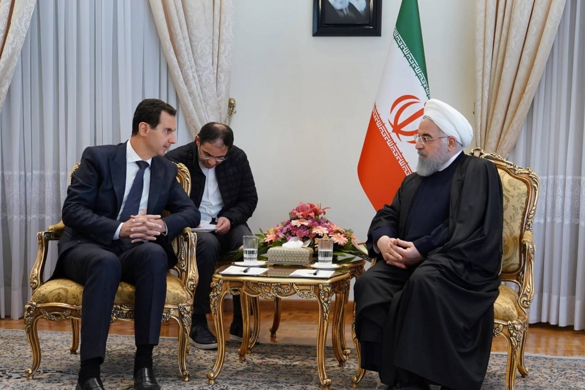 Syrian President Bashar Al-Assad (L) and Iranian President Hassan Rouhani in Tehran, Iran on 25 February 2019