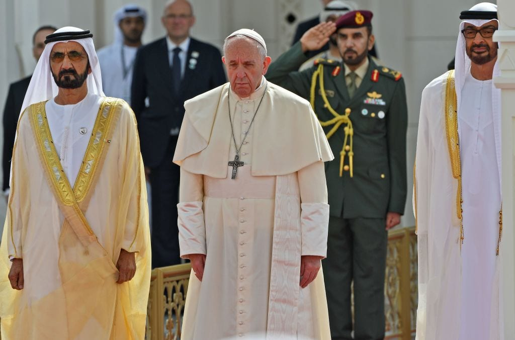 Pope Francis (C) is welcomed by Dubai ruler Sheikh Mohammed bin Rashid Al-Maktoum (L) and Abu Dhabi's Crown Prince Mohammed bin Zayed al-Nahyan (R) upon his arrival to the presidential palace in the UAE capital Abu Dhabi on 4 February 2019. [VINCENZO PINTO/AFP/Getty Images]