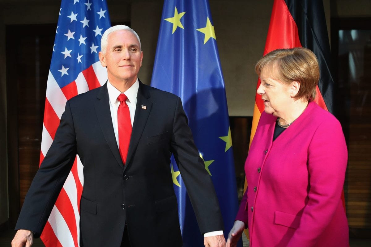 German Chancellor Angela Merkel (R) and US vice president Michael Pence are pictured during a photo call ahead of bilateral talks during the 55th Munich Security Conference (MSC) on 16 February 2019 in Munich, Germany. [Photo by Alexandra Beier/Getty Images]