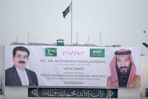 A welcoming banner featuring the portrait of Saudi Arabian Crown Prince Mohammed bin Salman (R) and Chairman of the Senate of Pakistan, Sadiq Sanjrani, is displayed on the building of the Parliament House in Islamabad on 17 February 2019. [AAMIR QURESHI/AFP/Getty Images]