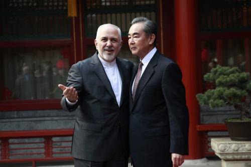 Iran's Foreign Minister Mohammad Javad Zarif (L) gestures as he speaks with his Chinese counterpart Wang Yi during their meeting at the Diaoyutai State Guesthouse in Beijing on 19 February 2019. [HOW HWEE YOUNG/AFP/Getty Images]