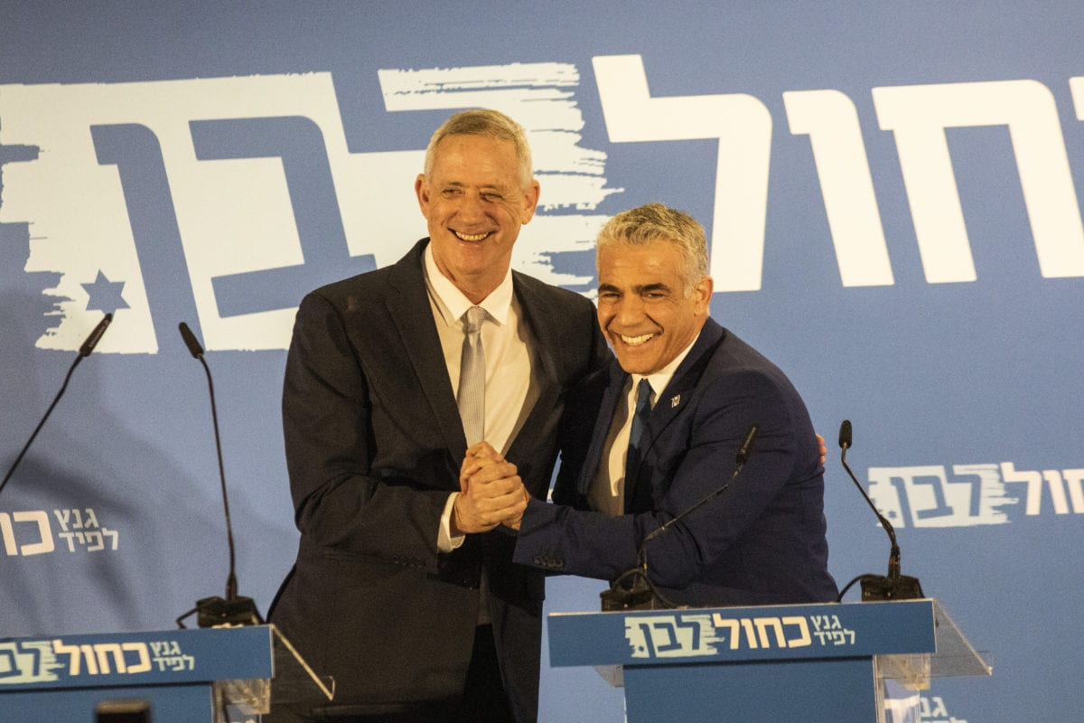 Benny Gantz and Yair Lapid seen on stage during the announcement of the new Blue and White Alliance on 21 February 2019 in Tel Aviv, Isreal. [Ilia Yefimovich/Getty Images]
