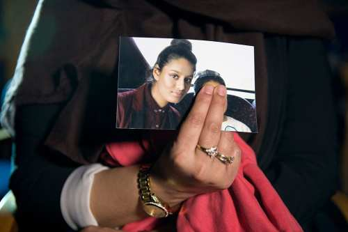 Renu Begum, eldest sister of Shamima Begum, 15, holds her sister's photo as she is interviewed by the media at New Scotland Yard, as the relatives of three missing schoolgirls believed to have fled to Syria to join Daesh have pleaded for them to return home, on 22 February 2015 in London, England. [Laura Lean - WPA Pool/Getty Images]
