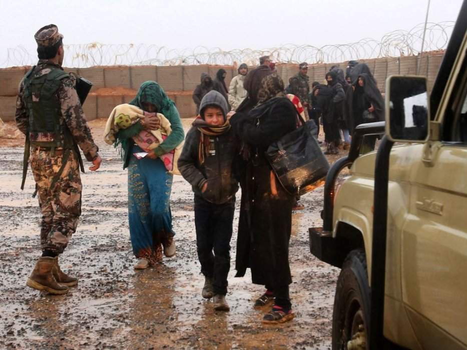 Syrian refugee patients from the makeshift Rukban camp, which lies in no-man's-land off the border between Syria and Jordan in the remote northeast, cross over to visit a UN-operated medical clinic immediately on the Jordanian-side for checkups, on March 1, 2017. [KHALIL MAZRAAWI/AFP/Getty Images]
