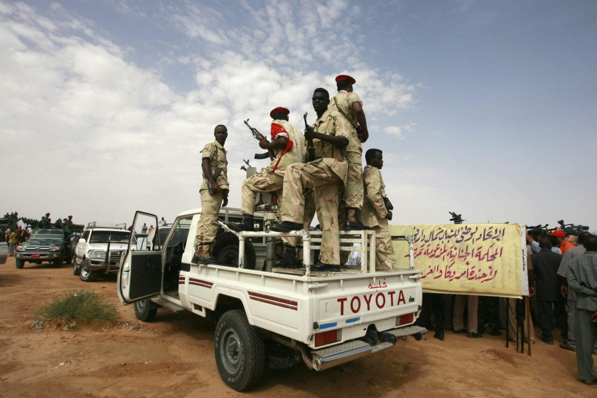 Sudanese presidental guards secure the area during a speech by President Omar al-Beshir in El-Fasher, north Darfur on 23 July 2008. [KHALED DESOUKI/AFP/Getty Images]