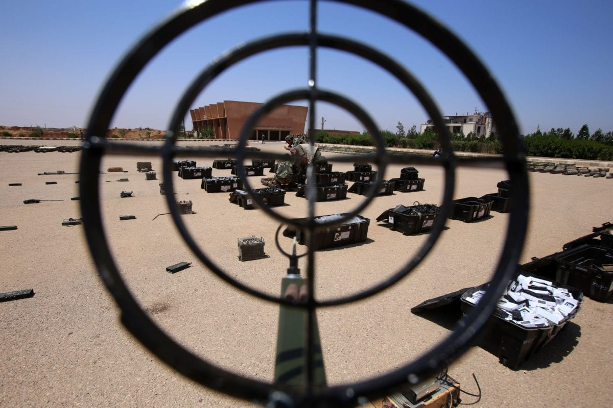 Syrian government forces' soldiers display weapons confiscated from the rebels in a Syrian army military base in the town of Ezraa, province of Daraa, on 4 July, 2018 [YOUSSEF KARWASHAN/AFP/Getty Images]