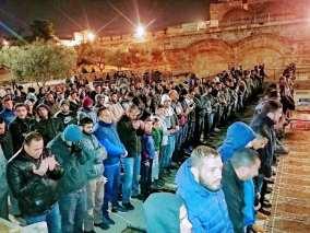 Palestinian pray at AlRahma Gate of Al-Aqsa Mosque on 20 February 2019